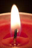 Red candle flame closeup. Close up of a red candle Royalty Free Stock Images