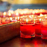 Red candle in glass Stock Photos