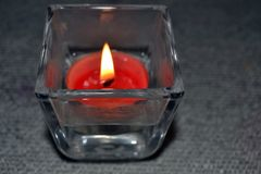 Red candle in a glass lantern. Stock Images