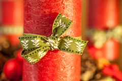 Red candle with green ribbon Royalty Free Stock Photo