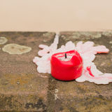 Red candle of grief on the curbs of a road Stock Photography