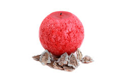 Red candle isolated on white and Christmas decoration Royalty Free Stock Image