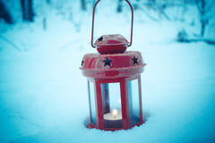 Red candle lantern with candle in snow Stock Photography