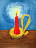 Red candle lighting up the dark blue night. In a yellow,  gold and brass colored candle holder with an old fashioned looking handle, a red candle burns brightly Royalty Free Stock Photos