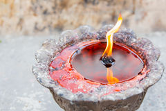 Red candle with liquid wax Stock Images