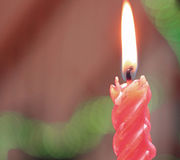 Red candle lit to celebrate Christmas day Stock Photo