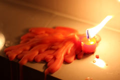 Red candle melting on white mable Royalty Free Stock Image
