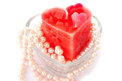 Red candle and necklace Royalty Free Stock Images