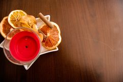 Red candle and oranges in a star Royalty Free Stock Photography