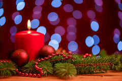 Red candle and ornament  on pine branch on table Royalty Free Stock Images