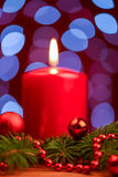 Red candle and ornament on pine wrench Stock Photos