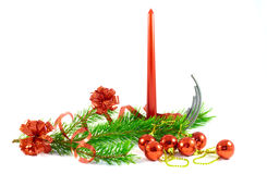Red candle with pine branch and  Christmas tree decorations. Royalty Free Stock Images