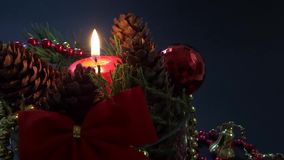 Red candle with pine ornament stock footage