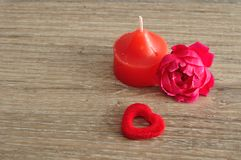 A red candle, a pink rose and a red heart Royalty Free Stock Photo