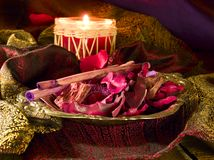 Red candle & potpourri still life Stock Photography
