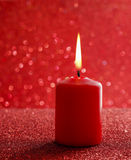Red candle. Red glittering christmas lights. Blurred abstract ba Royalty Free Stock Photo