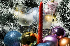 Red candle, silver tinsel and blue,gold balls Stock Images