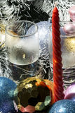 Red candle, silver tinsel and blue,gold balls. New Year red candle, silver tinsel and blue,gold balls royalty free stock images