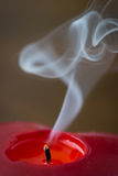 Red candle with smoke Royalty Free Stock Photos