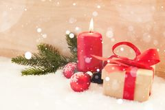Red candle in the snow at Christmas stock images