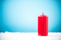 Red candle in snow, Christmas design template.  Royalty Free Stock Photography