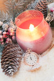 Red candle in snow Royalty Free Stock Images