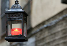 Red candle in streets of Barcelona. Royalty Free Stock Images