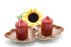 Red candle with sunflower Stock Images
