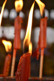 Red candle in Thai temple.  Stock Photos