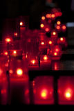 Red Candles. In Santa Maria del Mar, Barcelona.Focus on the third queue Royalty Free Stock Photography