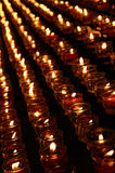 Red candles. Rows of red candles in church royalty free stock photography
