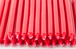 Red candles. Arranged in a row Royalty Free Stock Image