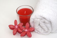 Red Candles Bathroom. Relaxing red scented candles and crisp white bath towel for a soothing bath time Royalty Free Stock Photos