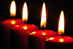Red candles with black background Stock Photo