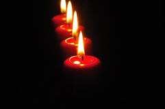 Red candles with black background Royalty Free Stock Images