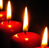 Red candles with black background Stock Photos