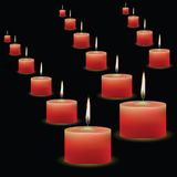 Red candles on black background Stock Image
