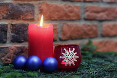 Red candles with blue christmas ball Stock Image