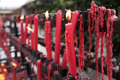Red candles at a Buddhist temple Stock Photos