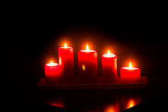 Red candles burning Stock Images