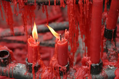 Red candles burning in a Buddhist shrine Stock Photo