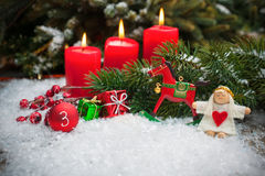 Red candles burning  in snow for third advent Royalty Free Stock Photography