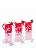 Red candles, candle holders with crystal snowflakes and sugar canes  on reflective white perspex background with copy spac. E, christmas background, xmas banner Royalty Free Stock Photography