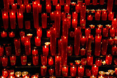 Red candles in cathedral. Red candles in old catholic cathedral royalty free stock image