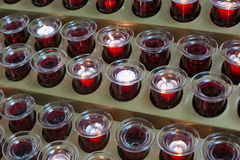 Red candles in a catholic church. Stock Image