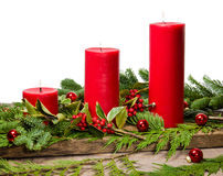 Red candles with cedar boughs Stock Image