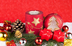 Red candles - christmas  background. Red different xmas candles with decoration on red background Stock Photos