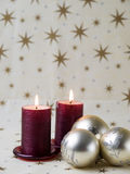 Red candles and Christmas balls Stock Photography