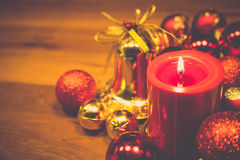 Red candles with christmas balls in retro color style Royalty Free Stock Images