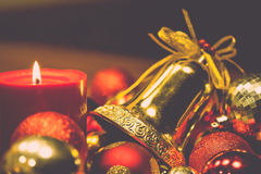 Red candles with christmas balls in retro color style Stock Photography